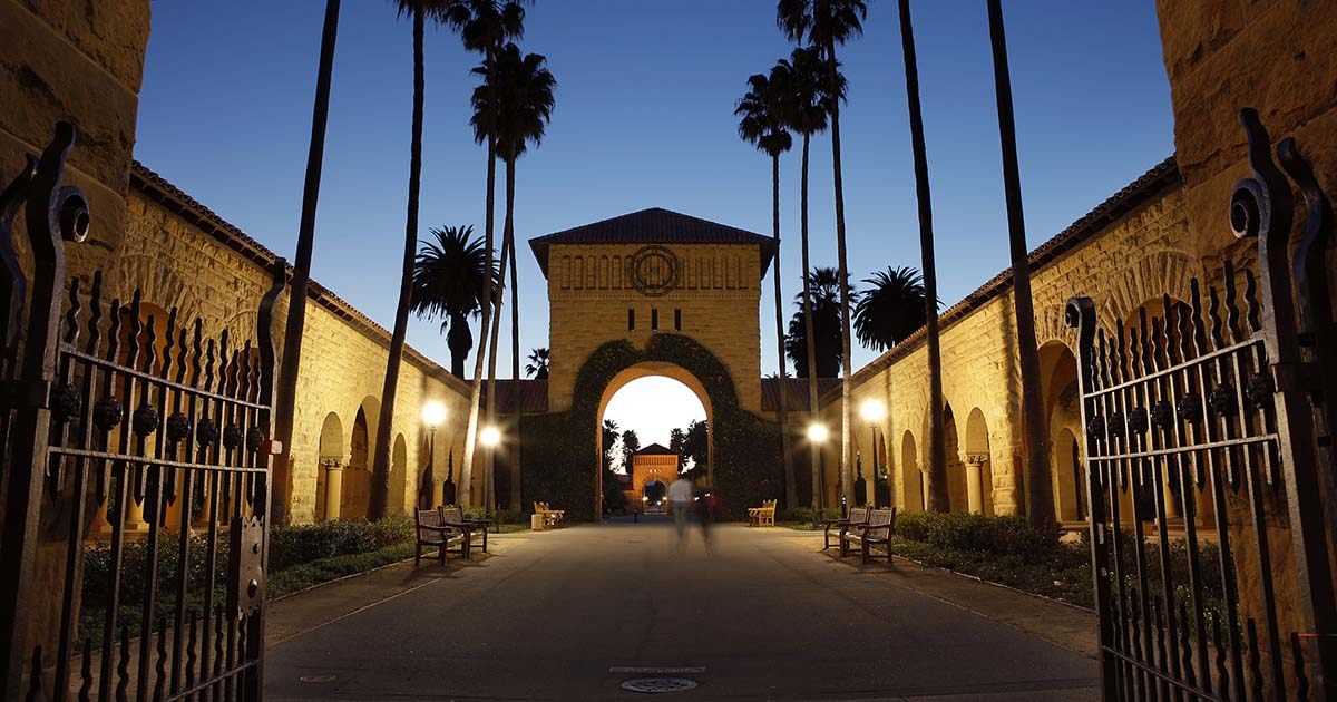View of the east entrance to the Main Quad at nighttest (Photo Credit: University Website) - Knight-Hennessy
